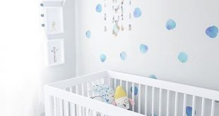 Loving this white nursery with watercolor dot wall decals.