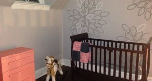 My little girl's nursery accent wall - used bristol board homemade flower st...
