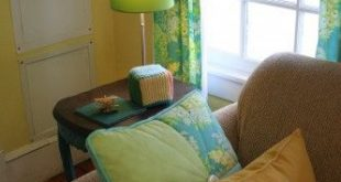 A happy yellow, green, blue and teal nursery with DIY touches and hand-me-down t...