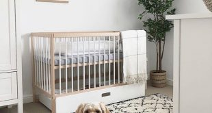 Gender neutral nursery decor inspiration with Mokee cot bed in natural wood. Cre...