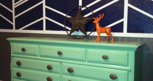 Nontraditional rustic boys nursery, accent wall and dresser. Navy, orange and se...